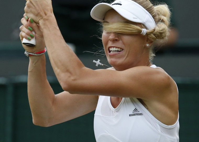 Caroline Wozniacki of Denmark hits a return to Naomi Broady of Britain during their women's singles tennis match at the Wimbledon Tennis Championships, in London, in this June 25, 2014 file photo. REUTERS/Suzanne Plunkett/Files