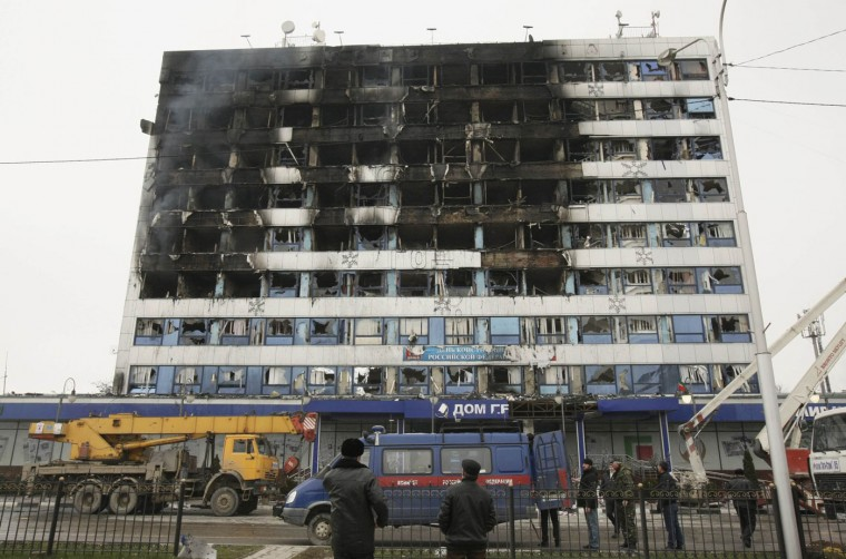 The burnt exterior of the Press House, a local media agency, is seen in the Chechen capital Grozny, December 4, 2014. At least six gunmen and three policemen were killed in gun battles in which a building was stormed in the Chechen capital Grozny on Thursday, the leader of the turbulent southern Russian region said. REUTERS/Stringer
