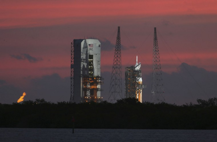 The Delta IV Heavy rocket carrying the Orion spacecraft sits on the launch pad awaiting liftoff in the sunrise at the Cape Canaveral Air Force Station in Cape Canaveral, Florida December 4, 2014. REUTERS/Scott Audette