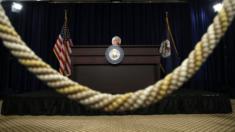 "U.S. Federal Reserve Chair Janet Yellen speaks during a news conference at the Federal Reserve in Washington December 17, 2014. The Federal Reserve on Wednesday offered a strong signal that it was on track to raise interest rates sometime next year, altering a pledge to keep them near zero for a ""considerable time"" in a show of confidence in the U.S. economy. REUTERS/Kevin Lamarque"