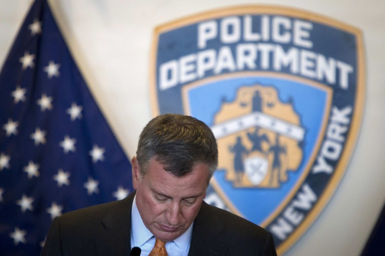 New York City Mayor Bill de Blasio speaks at a news conference at the New York Police Academy in the Queens borough of New York December 4, 2014. The mayor discussed newly implemented training procedures in the wake of the chokehold death of Eric Garner. REUTERS/Carlo Allegri
