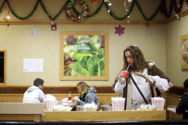 """Michael Grant, 28, """"Philly Jesus,"""" sips from a free cup of water at a Wendy's restaurant in Philadelphia, Pennsylvania December 14, 2014. (Mark Makela/Reuters)"""