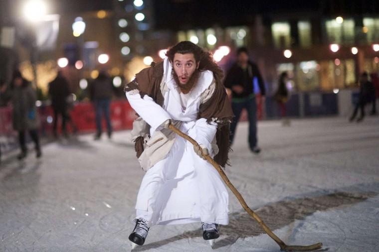 "Using his walking staff as a makeshift hockey stick, Michael Grant, 28, ""Philly Jesus,"" skates at Rothman Ice Rink in Philadelphia, Pennsylvania December 14, 2014. (Mark Makela/Reuters)"