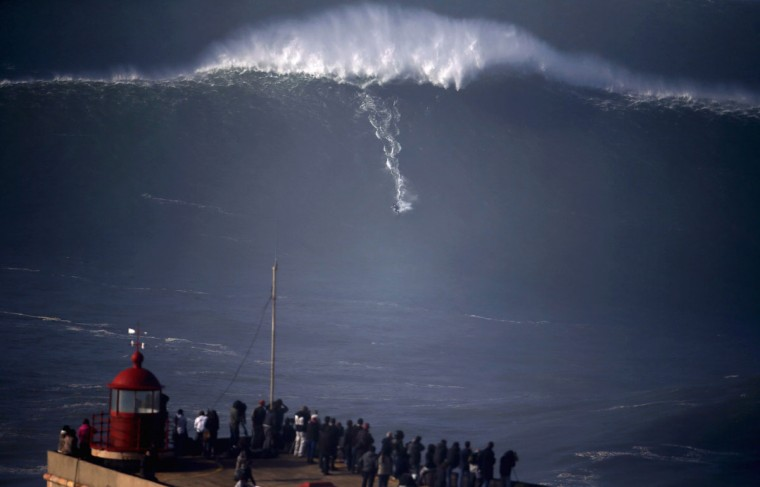 A surfer drops in on a large wave at Praia do Norte, in Nazare December 11, 2014. Praia do Norte beach has gained popularity with big wave surfers since Hawaiian surfer Garrett McNamara broke a world record for the largest wave surfed here in 2011 .(REUTERS/Rafael Marchante)
