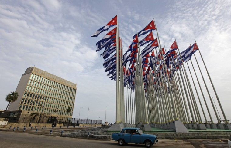 A car drives past the building of the the U.S. diplomatic mission in Cuba, The U.S. Interests Section, (USINT), in Havana, in this September 12, 2013 file picture. Cuba has released American aid worker Alan Gross after five years in prison in a reported prisoner exchange with Havana that the United States said on Wednesday heralds an overhaul of U.S. policy toward Cuba. REUTERS/Desmond Boylan/Files