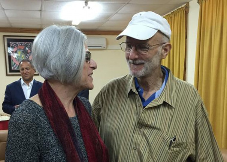 American aid worker Alan Gross (R) speaks with his wife Judy shortly before leaving Havana on December 17, 2014 in this photo tweeted by U.S. Sen. Jeff Flake (R-AZ). U.S. President Barack Obama was set to announce a shift in policy toward Cuba on Wednesday and the Associated Press reported the changes would include the opening of an embassy in Cuba and the start of talks to normalize relations. REUTERS/Courtesy the office of Arizona Senator Jeff Flake/Handout