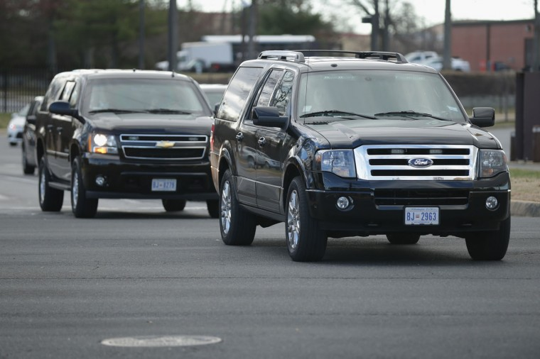 Two government vehicles, possibly with U.S. Agency for International Development contractor Alan Gross on board leave Air Force Joint Base Andrews in Prince Georges County December 17, 2014 in Joint Base Andrews, Maryland. Gross, who has been in prison in Cuba for the last five years on espionage charges, has been released and is due to arrive at the base, possibly heralding a new era in U.S.-Cuba relations. American officials have said they will restore full diplomatic relations with Cuba and open an embassy in Havana for the first time in more than a half-century. (Photo by Chip Somodevilla/Getty Images)
