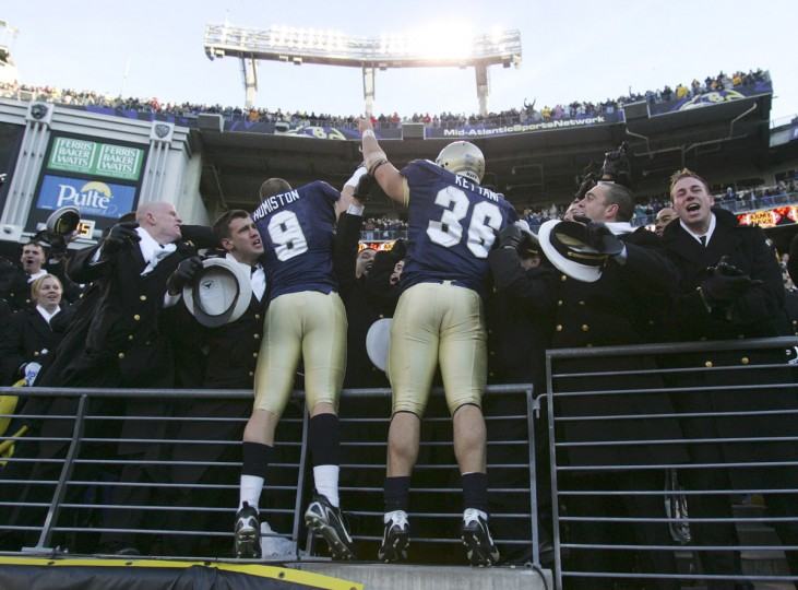 Navy's Matt Humiston (9) and Eric Kettani (36) celebrate with fellow Midshipmen after Navy defeated Army 38-3 on Dec. 1, 2007 at M&T Bank Stadium. (AP Photo/Rob Carr)