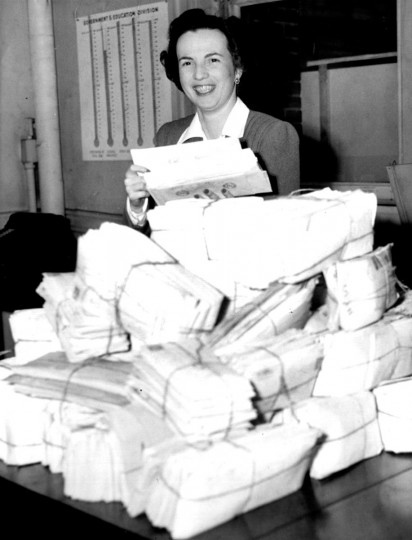 A woman sifts through Army-Navy ticket requests on Nov. 25, 1944. (Baltimore Sun file photo)