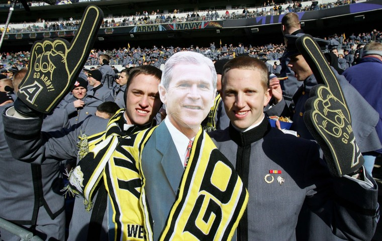 Army cadets pose with a likeness of president George W. Bush prior to the 108th Army-Navy football game on December 1, 2007 at M&T Bank Stadium. (Photo by Jim McIsaac/Getty Images)