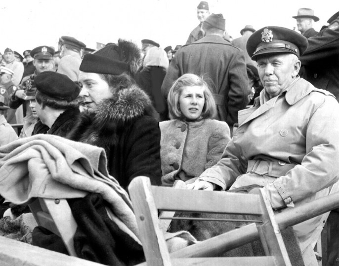 Gen. George C. Marshall is pictured with Sonia Hill, daughter of Lady John Hill, at the 1944 Army-Navy game in Baltimore. (Baltimore Sun file photo)