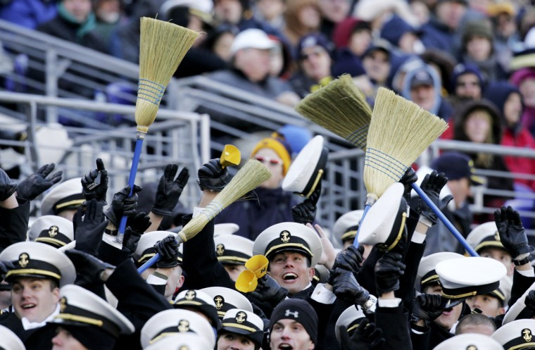 Navy Midshipmen celebrate during the first half against Army on Dec. 1, 2007. (AP Photo/Rob Carr)