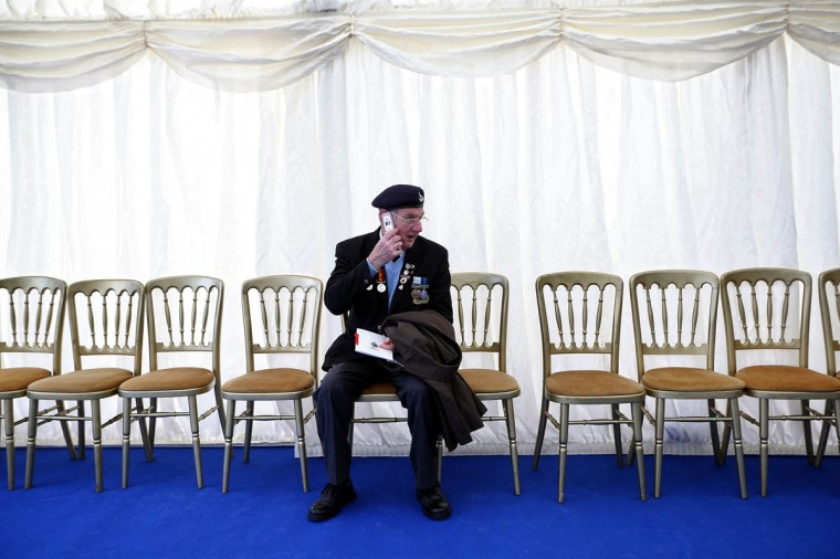 A veteran chats on his phone during the unveiling ceremony of London's first public memorial to the Korean War on December 3, 2014 in London, England. The ceremony was attended by 300 members of the British Korean's Veterans Association and was led by the Duke of Gloucester. (Carl Court/Getty Images)