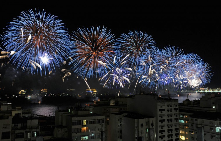 The Copacabana fireworks are seen from the Chapéu Mangueira slum during New Year celebrations in Rio de Janeiro on January 1, 2015. (Tasso Marcelo/Getty Images)