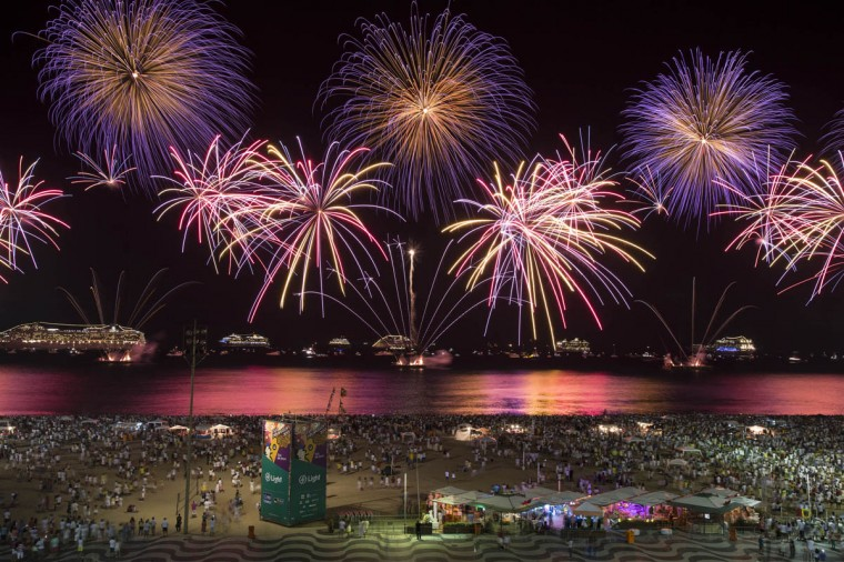 People watch fireworks exploding over Copacabana beach during New Year celebrations in Rio de Janeiro, Brazil, Thursday, Jan. 1, 2015. (Felipe Dana/AP photo)