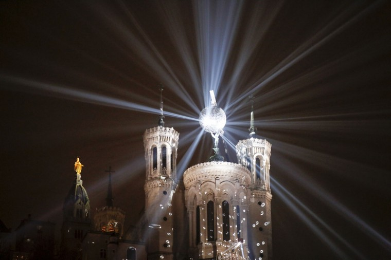 View of the Basilica of Fourviere with a mirror ball during the rehearsal for the Festival of Lights in central Lyon late in the night December 4, 2014. (REUTERS/Robert Pratta)