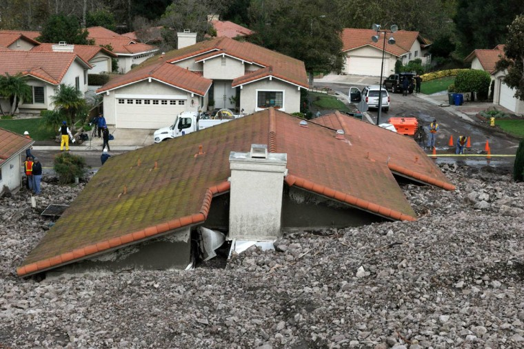 TV news crews set up across from a damaged home after a mud slide overtook at least 18 homes during heavy rains in Camarillo Springs, California December 12, 2014. (Jonathan Alcorn/Reuters photo)