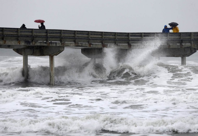 High waves crash under the Ocean Beach Pier as a winter storm brings rain and high winds to San Diego, California December 12, 2014. (Mike Blake/Reuters photo)