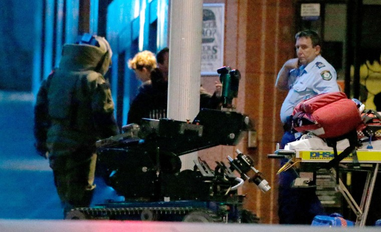 An anti-explosives robot sits at the Lindt Cafe, Martin Place during a hostage standoff on December 16, 2014 in Sydney, Australia. Police stormed the Sydney cafe after a gunman had taken hostages, ending the standoff. (Photo by Daniel Munoz/Getty Images)