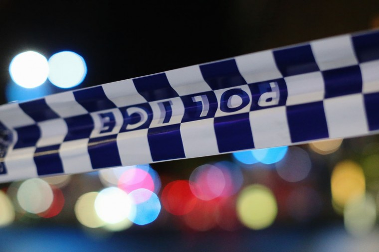 Police tape is streched near the Lindt Chocolate Cafe in Martin Place following a hostage standoff on December 16, 2014 in Sydney, Australia. Two were reported dead after police stormed the Sydney cafe after a gunman had been holding hostages for 16 hours. (Photo by Joosep Martinson/Getty Images)