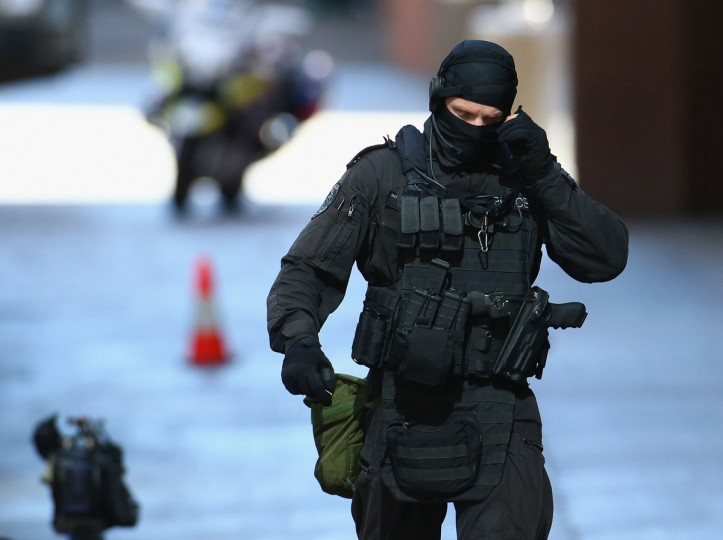 An armed policeman walks northward along Philip St , Martin Place on December 15, 2014 in Sydney, Australia. Police attend a hostage situation at Lindt Cafe in Martin Place. (Photo by Don Arnold/Getty Images)