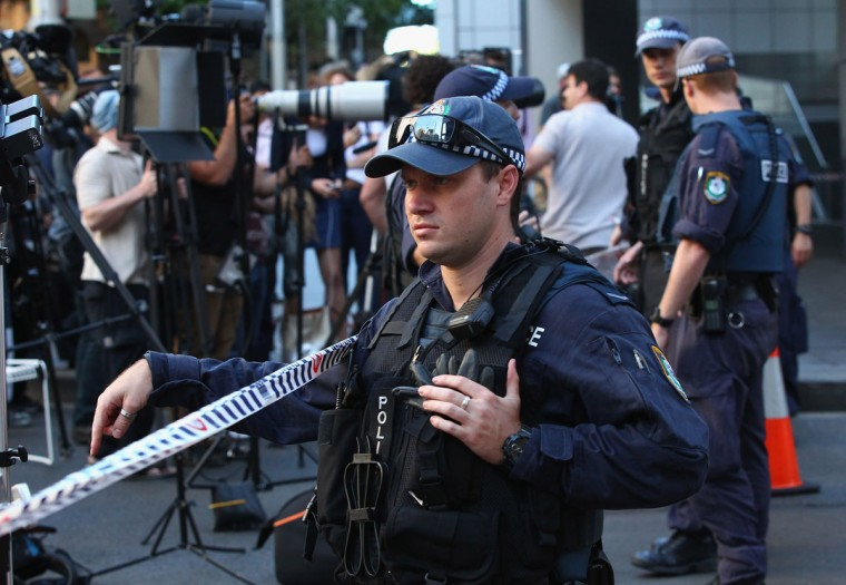 Police patrol the exclusion zone around Philip and Hunter Streets on December 15, 2014 in Sydney, Australia. (Photo by Don Arnold/Getty Images)