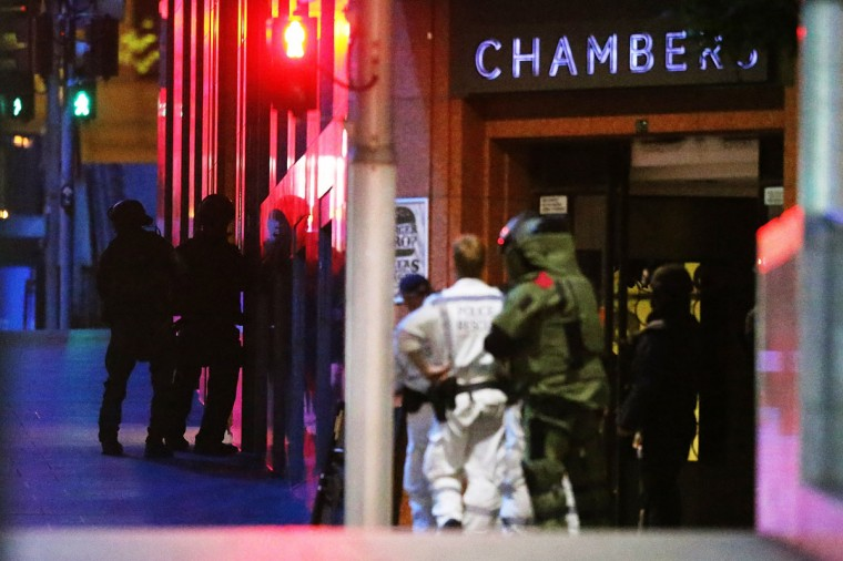 Police surround the Lindt Chocolate Cafe, Martin Place during a hostage standoff on December 15, 2014 in Sydney, Australia. (Photo by Joosep Martinson/Getty Images)