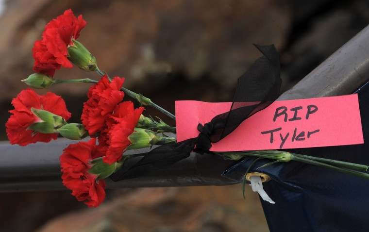 Flowers are left at an outdoor memorial in the plaza at The Mall in Columbia which reopened at 1pm today after the weekend shootings in which three people died including the Darion Marcus Aguilar, 19, who shot two victims. Tyler Johnson was one of the victims. Photo by Algerina Perna/Baltimore Sun