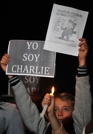 People take part in a demo to show solidarity for the victims of the attack on the offices of France's satirical weekly Charlie Hebdo, in Bogota, Colombia on January 7, 2015. Cities and towns worldwide staged vigils late Wednesday in solidarity with the French people after the massacre by Islamist gunmen in Paris against a satirical paper left at least 12 dead. (Guillermo Legaria/AFP/Getty Images)