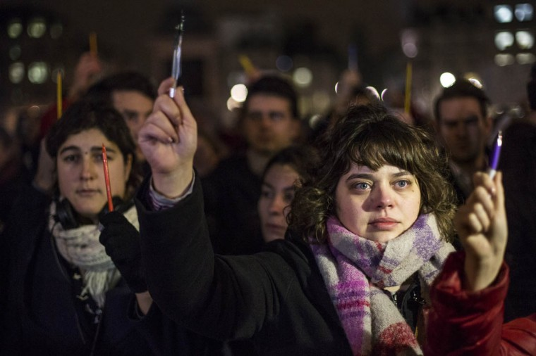 People hold pens aloft during a vigil in Trafalgar Square for victims of the terrorist attack in Paris on January 7, 2015 in London, United Kingdom. Twelve people were killed including two police officers as two gunmen opened fire at the offices of the French satirical publication Charlie Hebdo. (Rob Stothard/Getty Images)