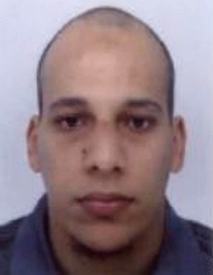 This photo released by French Police in Paris early on January 8, 2015 shows Cherif Kouachi, aged 32, a suspect wanted in connection with an attack at a satirical weekly in the French capital that killed at least 12 people. French police on January 8 published photos of Cherif Kouachi and his brother, wanted as suspects over the bloody massacre at the magazine in Paris, as they launched an appeal to the public for information. (AFP photo / French police)