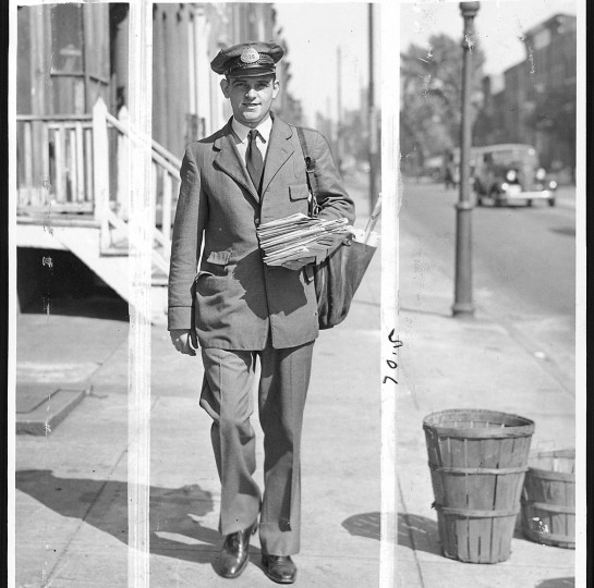 No matter the weather rain or shine, snow or sleet the postman is out delivering the mail. Sun file photo taken Sept. 21, 1937.