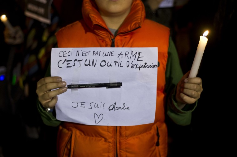 "A youth holds a sign reading ""Ceci n'est pas une arme, c'est un outil d'expression. Je Suis Charlie"" (This is not a weapon, but a tool of expression. I am Charlie) in support of the victims of the terrorist attack at the French magazine Charlie Hebdo, on January 8, 2015 in front of the French embassy in Mexico City. The massacre, the country's bloodiest attack in half a century, triggered poignant and spontaneous demonstrations of solidarity around the world. Charlie Hebdo is famed for its irreverent views of religion and its decision to publish controversial cartoons of the prophet Mohammed. Ronaldo Schemidt/AFP/Getty Images"