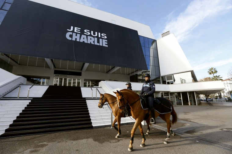 "Policemen patrol outside the Palais des Festivals in Cannes where a banner reading the ""Je suis Charlie"" has been deployed as a tribute to the satirical weekly Charlie Hebdo on January 9, 2015 . January 7 drama unfolded almost 48 hours into a massive manhunt launched after the brothers burst into the office of the satirical weekly Charlie Hebdo and gunned down staff members and two policemen, saying they were taking revenge for the magazine's publication of cartoons offensive to many Muslims. The number of people seized was not immediately confirmed. Valery Hache/AFP/Getty Images"