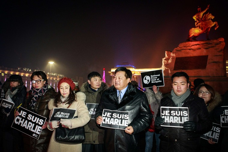 "Members of the French community and Mongolian journalists hold placards reading ""Je Suis Charlie"" (I am Charlie) as they take part in a candlelight vigil at Chinggis Square in Ulan Bator on January 9, 2015, in tribute to the victims killed after gunmen opened fire in the offices of French satirical weekly Charlie Hebdo in Paris. The massacre, the country's bloodiest attack in half a century, triggered poignant and spontaneous demonstrations of solidarity around the world. Charlie Hebdo is famed for its irreverent views of religion and its decision to publish controversial cartoons of the prophet Mohammed. Byamba-Ochir Byambasuren/AFP/Getty Images"