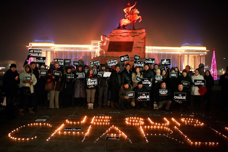 "Members of the French community and Mongolian journalists hold placards reading ""Je Suis Charlie"" (I am Charlie) as they take part in a candlelight vigil at Chinggis Square in Ulan Bator on January 9, 2015, in tribute to the victims killed after gunmen opened fire in the offices of French satirical weekly Charlie Hebdo in Paris. The massacre, the country's bloodiest attack in half a century, triggered poignant and spontaneous demonstrations of solidarity around the world. Charlie Hebdo is famed for its irreverent views of religion and its decision to publish controversial cartoons of the prophet Mohammed. Byambasuren Byamba-Ochir/AFP/Getty Images"