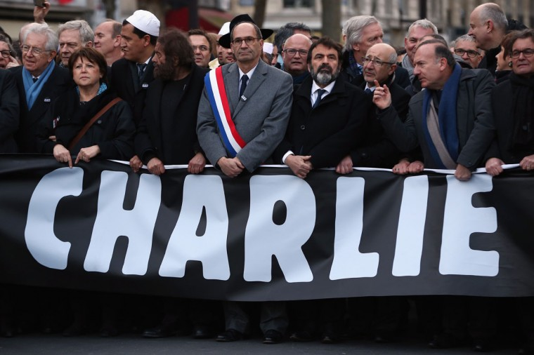 Dignitaries including (L-R) Mayor Of Lille Martine Aubry, Hassen Chalghoumi Imam of the Drancy mosque, philosopher Marek Halter and UMP politician Eric Woerth join demonstrators in Place de la Republique prior to a mass unity rally to be held in Paris following the recent terrorist attacks on January 11, 2015 in Paris, France. An estimated one million people are expected to converge in central Paris for the Unity March joining in solidarity with the 17 victims of this week's terrorist attacks in the country. French President Francois Hollande will lead the march and will be joined by world leaders in a sign of unity. The terrorist atrocities started on Wednesday with the attack on the French satirical magazine Charlie Hebdo, killing 12, and ended on Friday with sieges at a printing company in Dammartin en Goele and a Kosher supermarket in Paris with four hostages and three suspects being killed. A fourth suspect, Hayat Boumeddiene, 26, escaped and is wanted in connection with the murder of a policewoman. (Photo by Dan Kitwood/Getty Images)