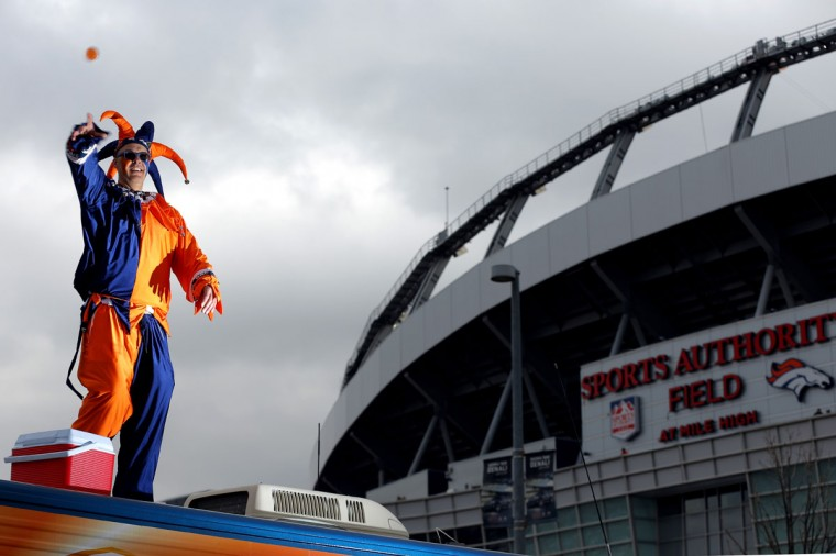 Denver Broncos fan Shane Hergenreder, of Denver, stands on top of his RV as he holds a tail gate party outside of the venue before a 2015 AFC Divisional Playoff game at Sports Authority Field at Mile High on January 11, 2015 in Denver, Colorado. (Photo by Justin Edmonds/Getty Images)