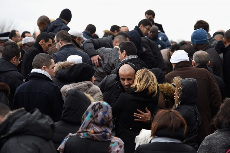A family member of police officer Ahmed Merabet, is seen during a funeral at a muslim cemetary on January 13, 2015 in Bobigny, France. The officers were awarded a posthumous Legion dHonneur, in recognition of their bravery. The terrorist attacks began on Wednesday with the assault on the French satirical magazine Charlie Hebdo, killing 12, and ended on Friday with sieges at a printing company in Dammartin en Goele and a Kosher supermarket in Paris with four hostages and three suspects being killed. A fourth suspect, Hayat Boumeddiene, 26, escaped and is wanted in connection with the murder of a policewoman. (Photo by Pascal Le Segretain/Getty Images)