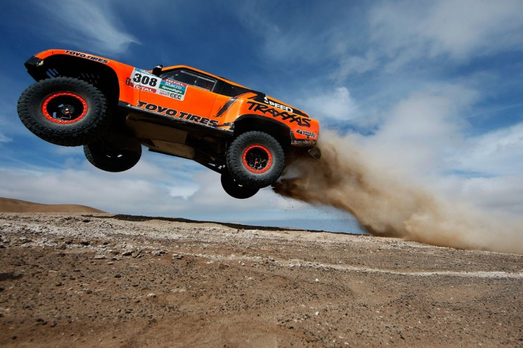 #308 Robby Gordon and Johnny Campbell of the USA driving for Speed Energy Racing HST Hummer launches over a jump in the Atacama Desert during day 10 of the Dakar Rally between Iquique on Calama January 13, 2015 in Iquique, Chile. (Photo by Dean Mouhtaropoulos/Getty Images)