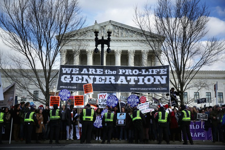 U.S. Capitol Police stand guard after pro-choice activists blocked the street and temporarily stopped the annual March for Life in front of the U.S. Supreme Court January 22, 2015 in Washington, DC. (Photo by Alex Wong/Getty Images)