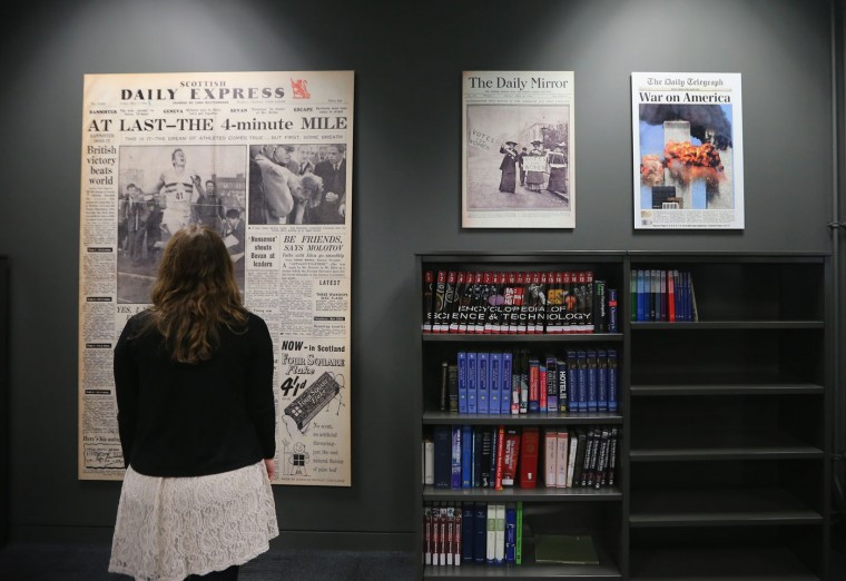A visitor to the new National Newspaper Archive views display copies of historic front pages in the reading room on January 23, 2015 in Boston Spa, United Kingdom. The British Librarys brand new National Newspaper Building officially opened today. The newly built storage void holds 60 million newspapers and periodicals spanning more than three centuries. The temperature and humidity controlled store is operated by robot cranes and can retrieve newspapers from any time and date. The British Library spent six months moving the archive from its previous home in Colindale, north London. (Photo by Christopher Furlong/Getty Images)