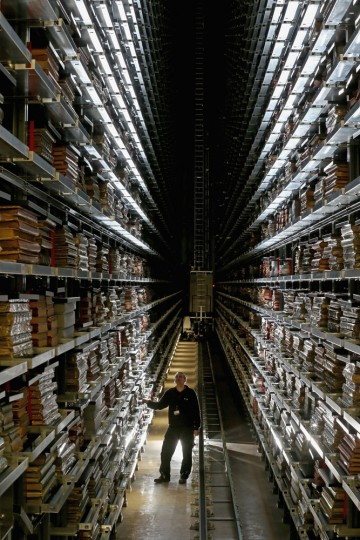 Resident engineer John Roberts poses as he looks at the millions of newspapers stored on racks at the National Newspaper Archive on January 23, 2015 in Boston Spa, United Kingdom. The British Librarys brand new National Newspaper Building officially opened today. The newly built storage void holds 60 million newspapers and periodicals spanning more than three centuries. The temperature and humidity controlled store is operated by robot cranes and can retrieve newspapers from any time and date. The British Library spent six months moving the archive from its previous home in Colindale, north London. (Photo by Christopher Furlong/Getty Images)