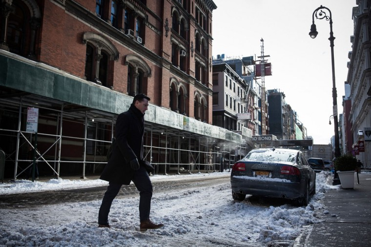 A man walks through the snow a day after the city was hit by a storm that left six inches of snow on the morning of January 28, 2015 in New York City. The storm was predicted to bring 20-30 inches of snow, causing roads, highways and trains to be shut down, before reopening again yesterday. (Photo by Andrew Burton/Getty Images)