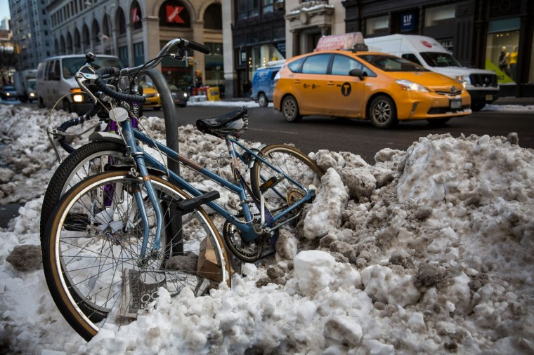 Two bikes sit engulfed in snow a day after the city was hit by a storm that left six inches of snow on the morning of January 28, 2015 in New York City. The storm was predicted to bring 20-30 inches of snow, causing roads, highways and trains to be shut down, before reopening again yesterday. (Photo by Andrew Burton/Getty Images)