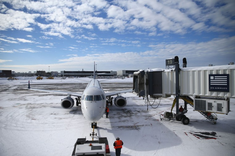 A plane taxis into its gate at Logan International Airport after the area was hit by Winter Storm Juno on January 28, 2015 in Boston, Massachusetts. Boston, and the rest of New England, picked up over two feet of snow from the storm. (Photo by Maddie Meyer/Getty Images)
