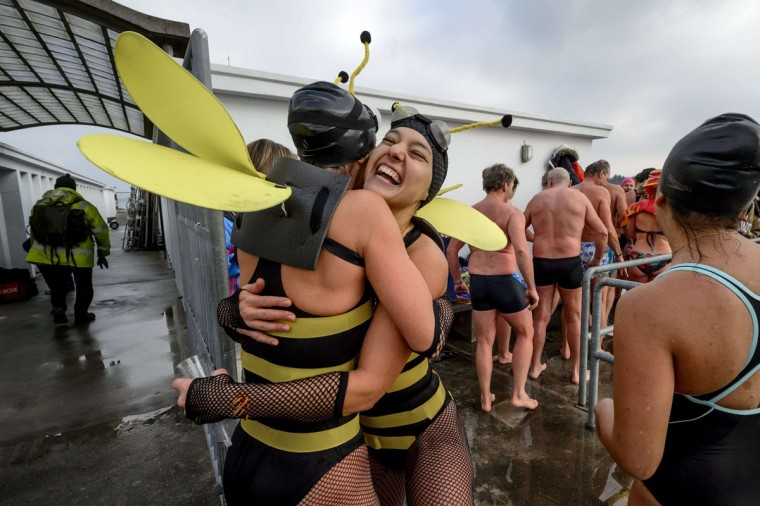 People embrace after participating in a New Years day swim in Lake Geneva in Geneva on January 1, 2015. Around 50 swimmers took part in the 21st edition of the traditional dip to mark the New Year. (Fabrice Coffrini/AFP/Getty Images)