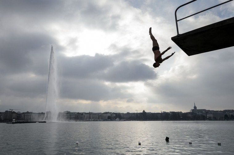 A man dives from a platform into the lake during a New Years day swim in Lake Geneva in Geneva on January 1, 2015. Around 50 swimmers took part in the 21st edition of the traditional dip to mark the New Year. (Fabrice Coffrini/AFP/Getty Images)