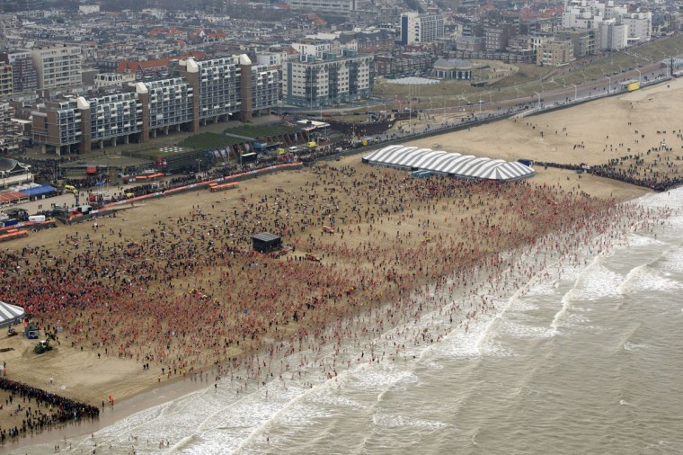 Participants run towards the North Sea during the traditional New Year's Dive to celebrate New Year 2015 on the beach in Scheveningen, on January 1, 2015. The New Year's dive was held for the fiftieth time in Scheveningen. (Bram Van Der Biezen/AFP/ANP/Getty Images)