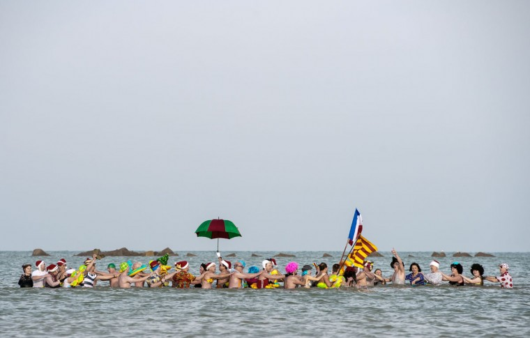 People participate in the traditional New Years dip in the sea at Malo-Les-Bains near Dunkirk on January 1, 2015. (Philippe Huguen/AFP/Getty Images)
